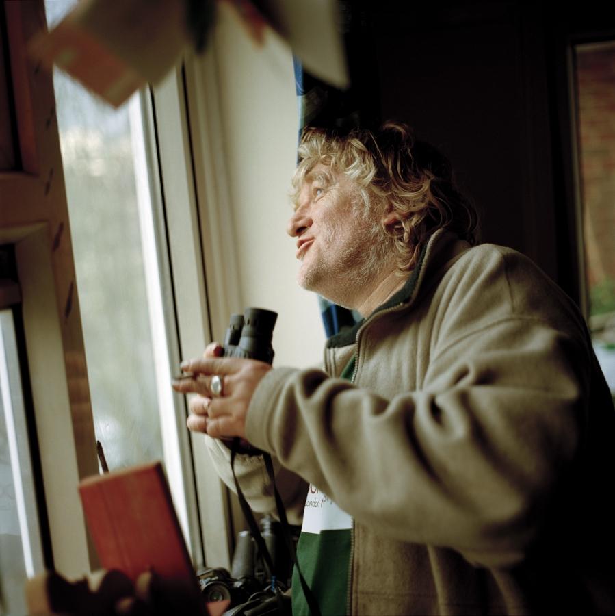 Loius Quail, from the series, BIG BROTHER, A bird is spotted out of Justin's Lounge window. Exhibition: CRAZY – Leben mit psychischen Erkrankungen. f3 – freiraum für fotografie